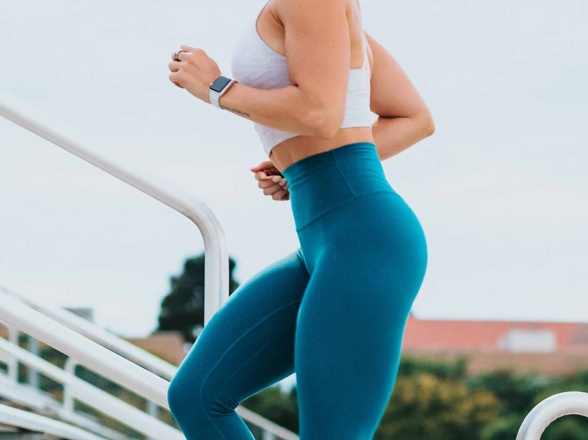 woman running up stairs apple watch